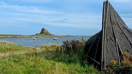 The Holy Island of Lindisfarne : Boat sheds and castle