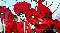 Remembrance poppy leadlight - on display in the gardens of Felbrigg Hall - Norfolk (OS Grid Ref. TG195394)